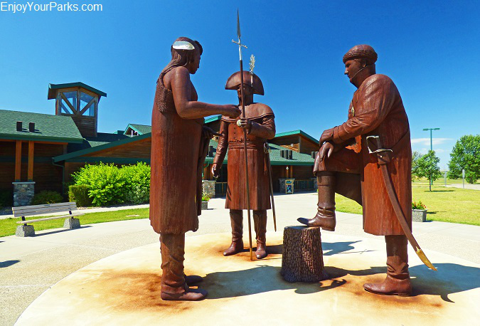 Statues of Lewis, Clark and Sacajawea standing in front of the North Dakota Interpretive Center