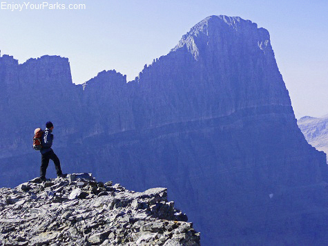 David standing on the summit of Cataract Mountain in Glacier Park, with Mount Gould as the backdrop.