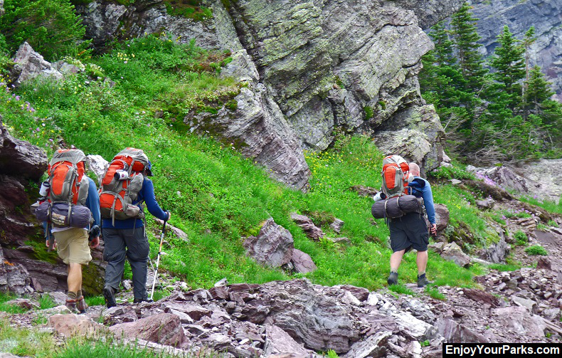 Backpackers on Gunsight Pass Trail in Glacier Park
