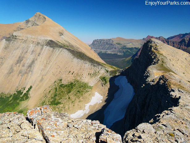 A view of Triple Divide Peak (right) and Mount James (left), with Triple Divide Pass between, Glacier National Park